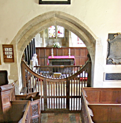 14. Chancel arch in Decorated style with 17th century oak gates.  There are no stalls in the chancel, which is typical of small churches up until the mid 19th century.