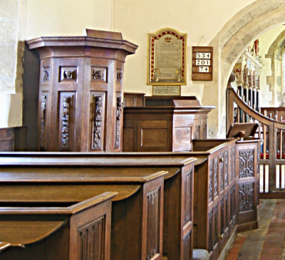 15. Three-decker 17th or 18th century pulpit, with carved saints and cherubs, and the lower clerk's and reader's desks.