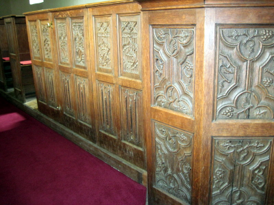 17. Panels around the pulpit with ornate Flemish carving.
