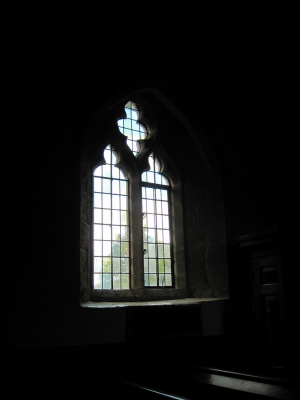 18. Clear leaded glass window, of the Decorated style, in the north wall by the pulpit.