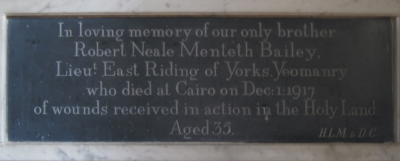 22. Wall tablet in memory of Robert Bailey, brother of Helen Lees-Milne.  He never lived in the village but his name is on the Great War  memorial tablet as she was his next-of-kin.