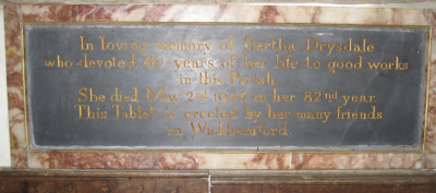 24. Wall tablet in memory of Bertha Drysdale.  Her son Roger's death is recorded on the Great War memorial tablet and Drysdale Close is  named in her honour.