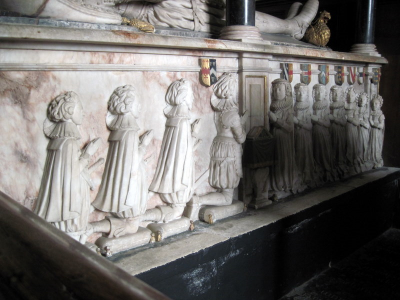 33. Carvings showing that Samuel and Mercy Sandys had 4 sons and 7 daughters.