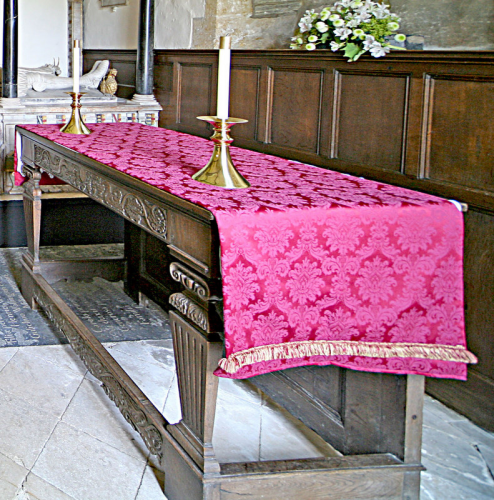 40. Communion table in the chancel - although not genuinely Jacobean, it is made of carved pieces of oak of that period.