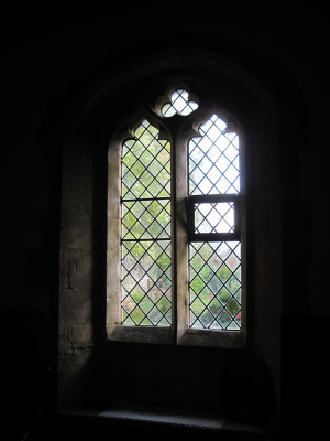 44. Decorated style clear glass window in the south wall of the chancel.