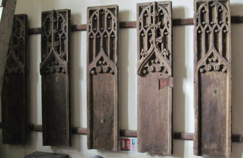 50. Five wooden panels with tracery, displayed in the vestry, are probably from a Perpendicular style pulpit.