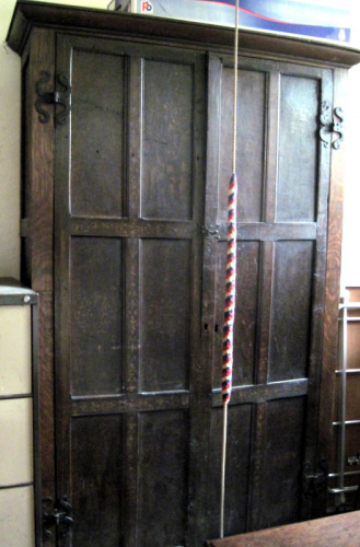 51. Cupboard in the vestry, made up from 16th century painted panels, probably from Ribbesfield House, near Bewdley.