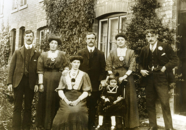 The row of four terrace houses where Emily Hartwell lived for over 30 years. George and Sarah Ann Brotherton (centre and seated) lived in another of the houses.