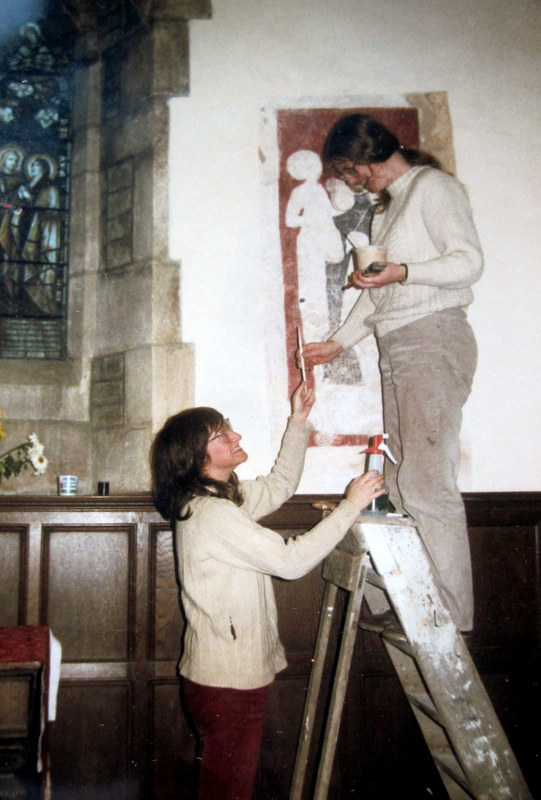 Eddie Sinclair and Anna Hulbert working on the painting of the Virgin and Child