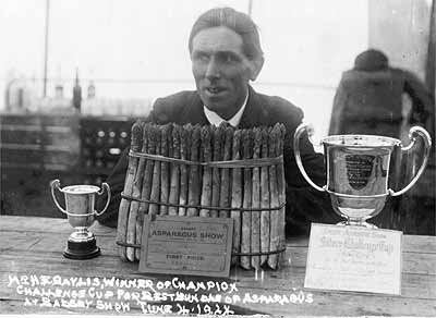 Enos Bayliss (1881-1964) in 1924 with his prize-winning trophy at the Vale of Evesham Asparagus Show