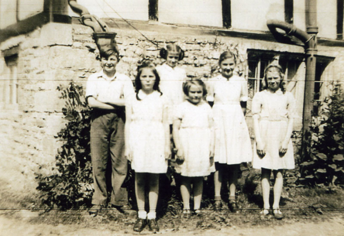 This picture, taken earlier than those above, is from 1945. Its was taken at the rear of Elm Farm, Manor Road, which was and still is, owned by the Daffurn family. The children are Derek Daffurn, Diana Daffurn, Denise Daffurn, Joan Martin, Ramona Daffurn and Marjorie Martin.