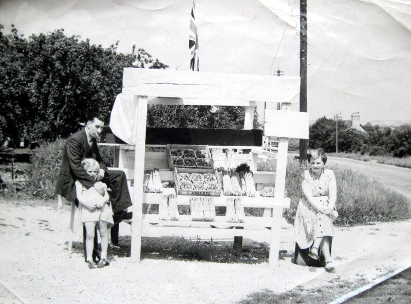 Les Roberts with his daughter, Jane, and wife Barbara (nee Dolphin) selling asparagus and soft fruit in punnets.