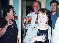 Mrs Jean James with Mr Gerry Hughes (Headmaster), Dr Peter Phillips (Chairman of the Governors) and Mrs Maggie Hughes (Headmaster's wife)