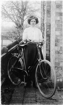Miss Maud Byrd, with bike (note carbide lamp) (c 1906)