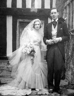 A picture taken outside the Manor on the Wedding Day of Audrey Lees-Milne and Matthew Arthur in 1931. She is seen here with her brother, Richard.
