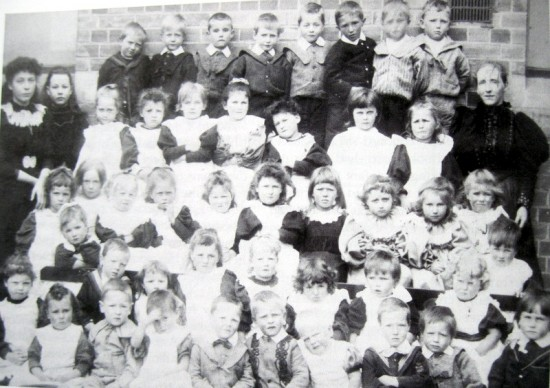 Elizabeth Mason, right, with a class of Badsey School pupils in 1898.