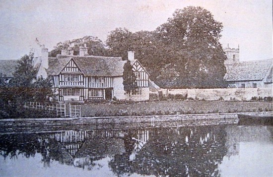 The East front of the Manor House in around 1901.  The wall separates the Manor grounds from the Church and until the 19th Century a stone barn stood in that vicinity.  Its stones may have been used to construct the wall.