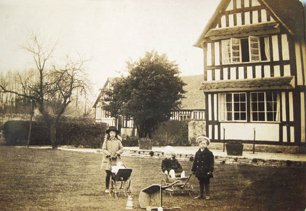 Audrey, Richard and James Lees-Milne in the garden of Wickhamford Manor in about 1913