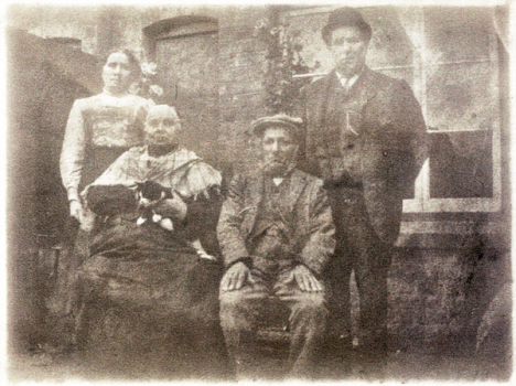 William and Emma Moore and, seated, the 'in laws' Charles and Comfort Colley who were living with the Moores in 1911.