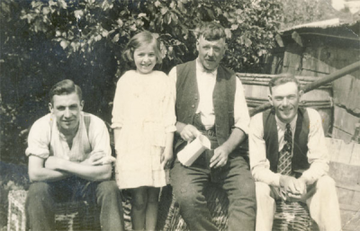 Charles Halford, with son, George, and daughter, Vera, with a neighbour, Ernie Cox, on the right.