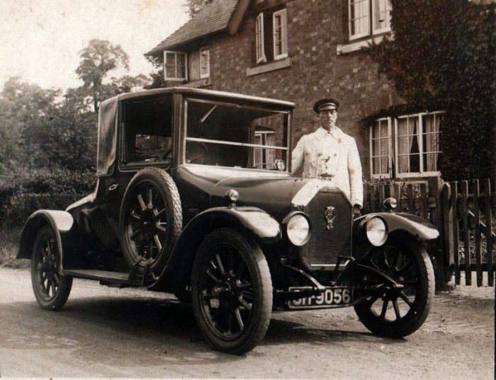Norris Haines resplendent in chauffeur's uniform, with George Lees-Milne's car, pictured outside of his house, 'Whytebury', in Manor Road.