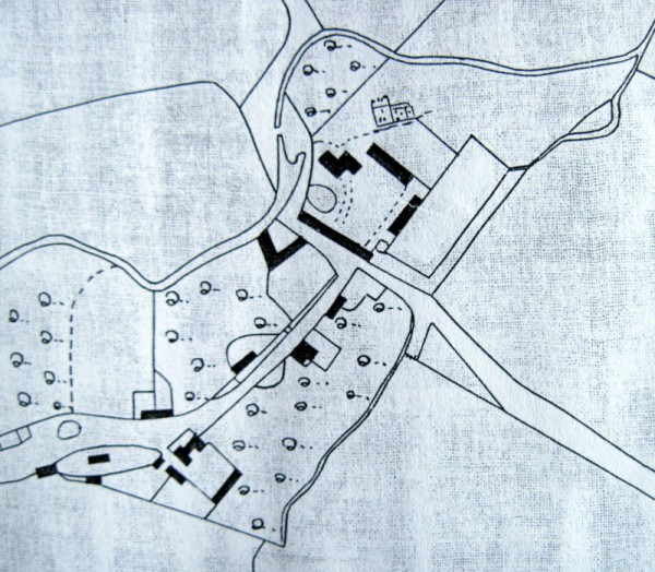 A map from the mid 19th century, with a drawing of the church and showing the location of a range of buildings at the rear of the Manor.