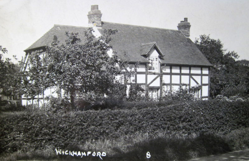 A postcard of Robin Cottage before its alteration to a thatched structure in the 1930s. The card was posted in 1928 by Mary Robbins to her daughter Lizzie and states that this was 'our house'.