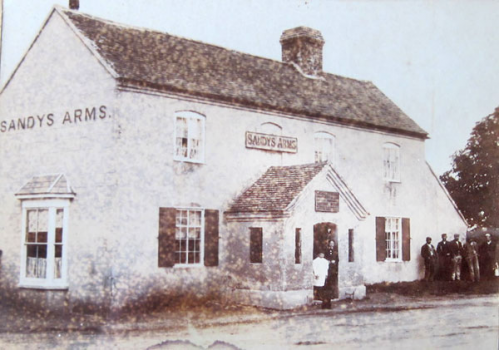 The Sandys Arms in the 1890s with Hannah Pethard and one of her children in the doorway.