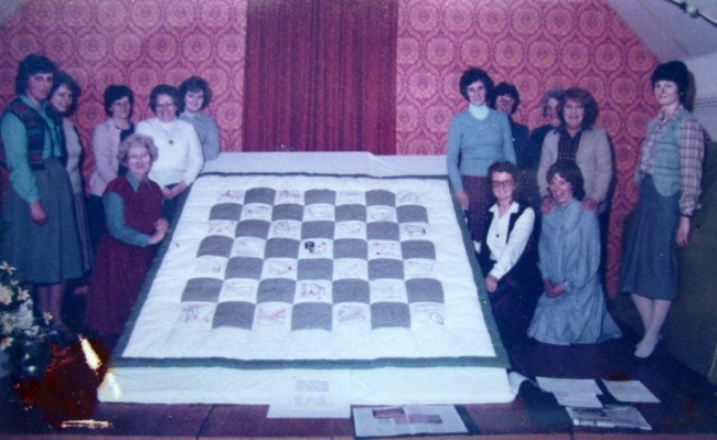 A quilt made by the W. I. completed in February 1984.