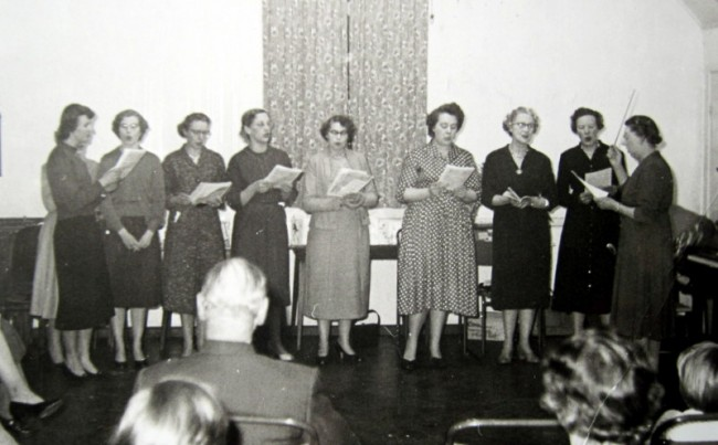 January 1959 – The W. I. Choir at Mr & Mrs Sturt's Golden Wedding Anniversary party.