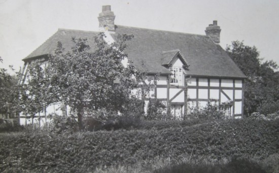 The brick and half-timbered cottage with a tiled roof that was later restyled and named 'Robin Cottage'.