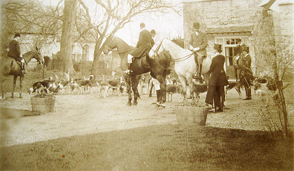 The hunt. The hunt meeting in front of Wickhamford Manor, with the church in the background, probably photographed between the wars.