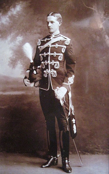 George Lees-Milne (1880-1949) in Hussar's uniform (before he lost his eye). His military service was in the Cheshire Yeomanry from 1901-1905. Yeomanry Regiments had uniforms based on regular cavalry design, usually Hussars but sometimes Lancers or Dragoons.