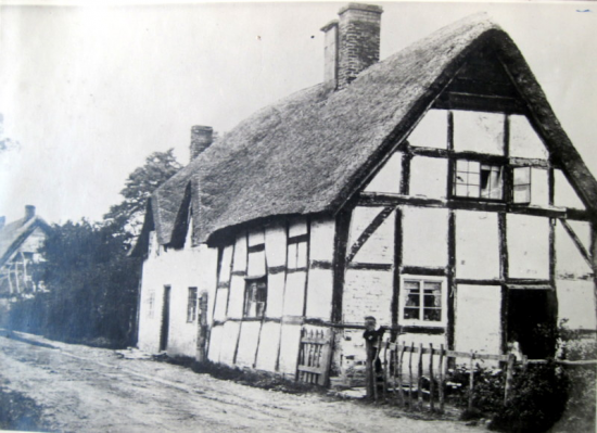 The pair of thatched cottages next to what is now Corner Cottage in the background.