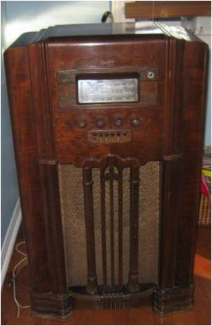 A wireless set housed in a walnut veneer cabinet.