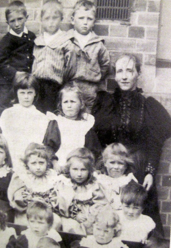 Elizabeth Mason with some of the children at Badsey School in 1898