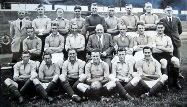 The Leicester City team in 1947-48.  Jack Haines is in the front row on the far right and the future England manager, Don Revie, is in the front row with the football.