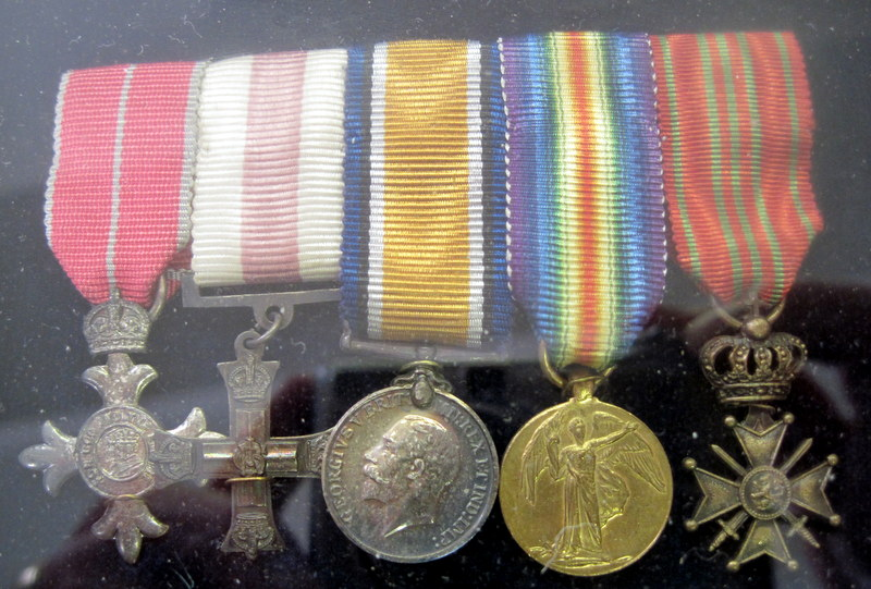 This set of miniature versions of his medals are, from the left, M.B.E., M.C. British War Medal, Victory Medal, the Belgian Croix de Guerre