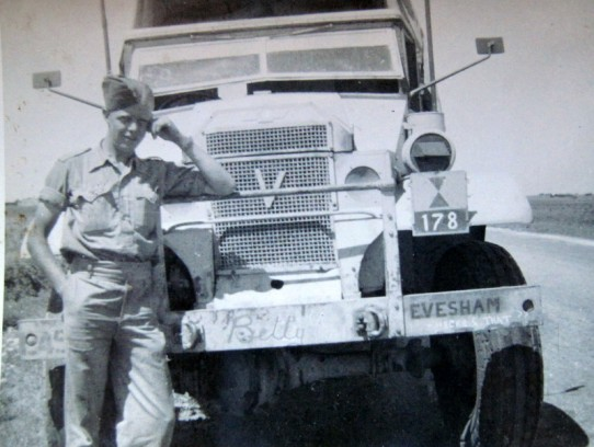 Harry in front of a truck named 'Evesham'