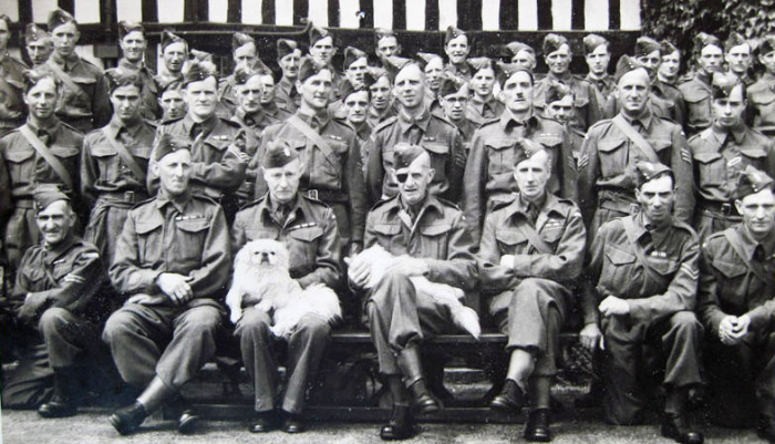 1. The Broadway Company outside Wickhamford Manor.   Major Lees-Milne with eye patch and Lieut Horsfield to his left.  (The date of the picture is not known).