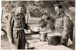 3. Bert Collett of Wickhamford (left) being fed whilst on exercises.