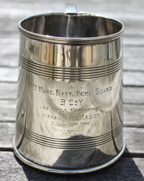 7. A silver tankard awarded to Pte Fred Mason of Wickhamford for his shooting in the .22 competition on 19th March 1944.