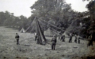 Erecting tents at a Tyddesley Wood camp