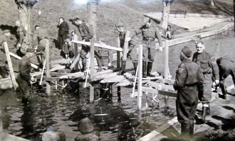 Pioneer Platoon building a bridge over the boating lake in Abbey Park, Evesham