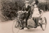 Hall family in motorcycle & sidecar