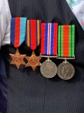 Ian Devine wearing his father William's war-time medals